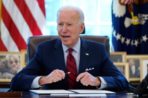 President Joe Biden speaking at his desk