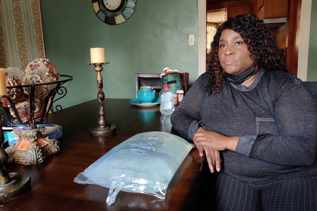 Tamiko Smith sitting with dialysis bag