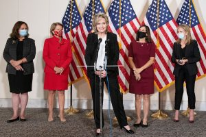 Senator Cindy Hyde-Smith speaks at a podium with Republican women behind her