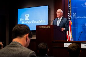 """Senator Roger Wicker speaks at a podium with the words """"The Heritage Foundation"""" on the wall behind him."""