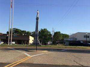 A tall Confederate statue stands in a median in a highway through Brandon, Miss., the county seat of Rankin County