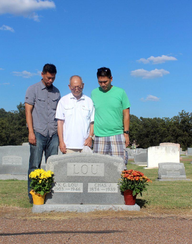 Chiu family visiting family grave