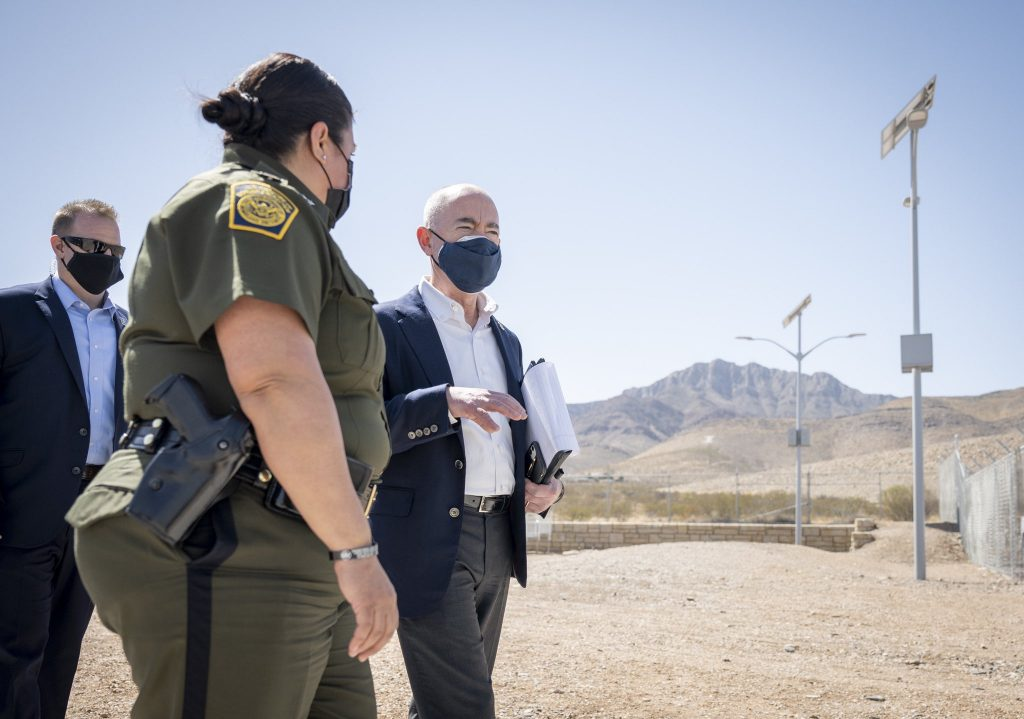 Secretary Mayorkas stands outside in El Paso with a Customs and Border agent