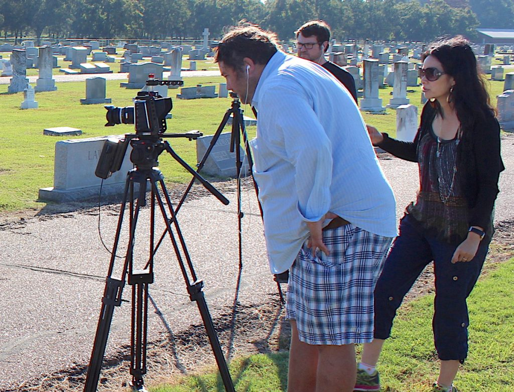 Crew filming Far East Deep South in cemetary