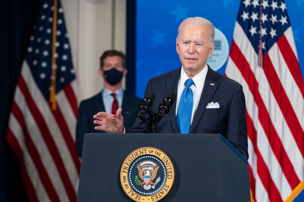 President Joe Biden speaking at podium