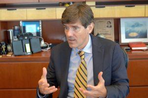 Thomas Dobbs speaking at his desk