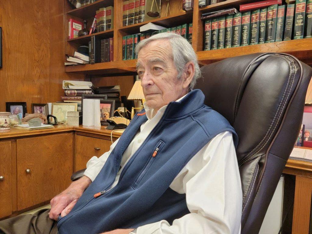 dale danks sitting at desk in office