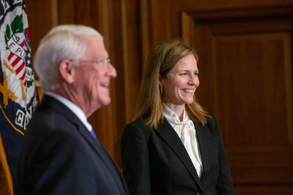 Senator Roger Wicker smiles alongside Amy Coney Barrett