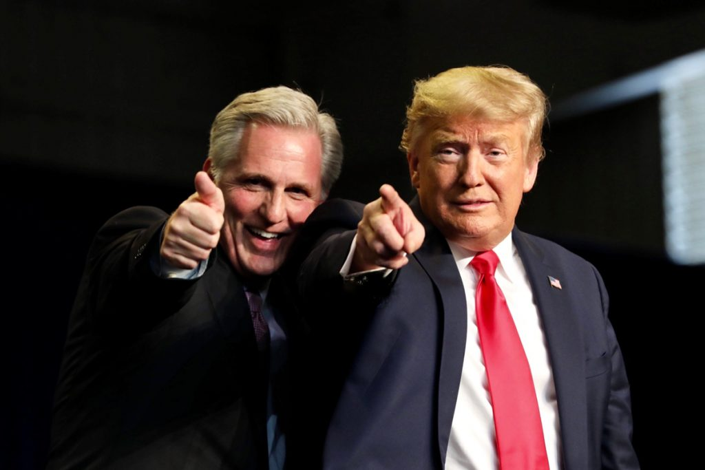 Kevin McCarthy holds a thumb up while Trump points at the camera