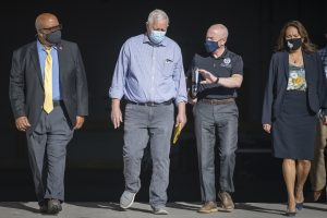 Bennie Thompson is seen walking on a road alongside three other people, including Homeland Security Secretary Alejandro Mayorkas