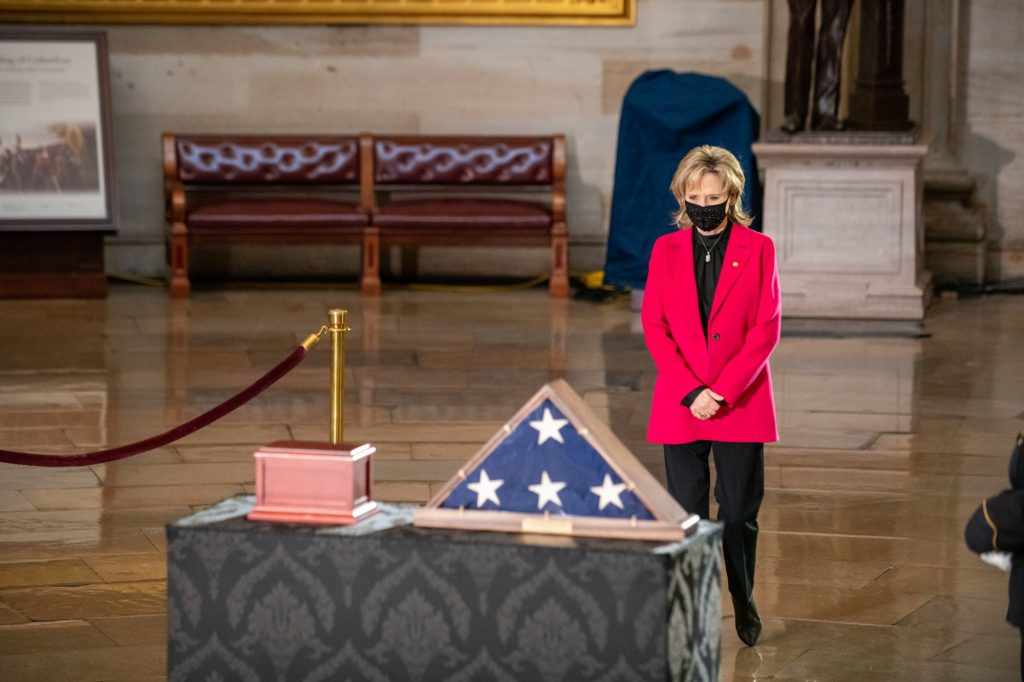 Cindy Hyde-Smith stands in the Capitol rotunda during a memorial for Brian Sicknick