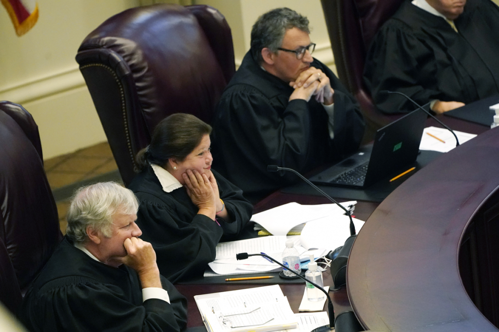 Mississippi Supreme Court Associate Justices T. Kenneth Griffis, left, Dawn Beam, center and Josiah Dennis Coleman