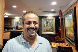 Yoseph Ali inside his restaurant, Aladdin Mediterranean Grill