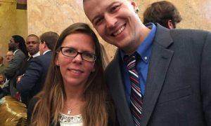 Representative Ashley Henley smiles with husband Brandon Henley inside the State Legislature