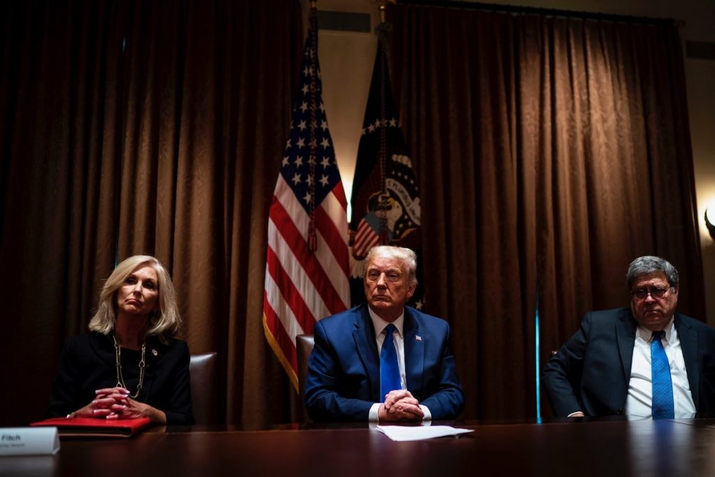 Lynn Fitch sits at a White House table next to Donald Trump and Bill Barr