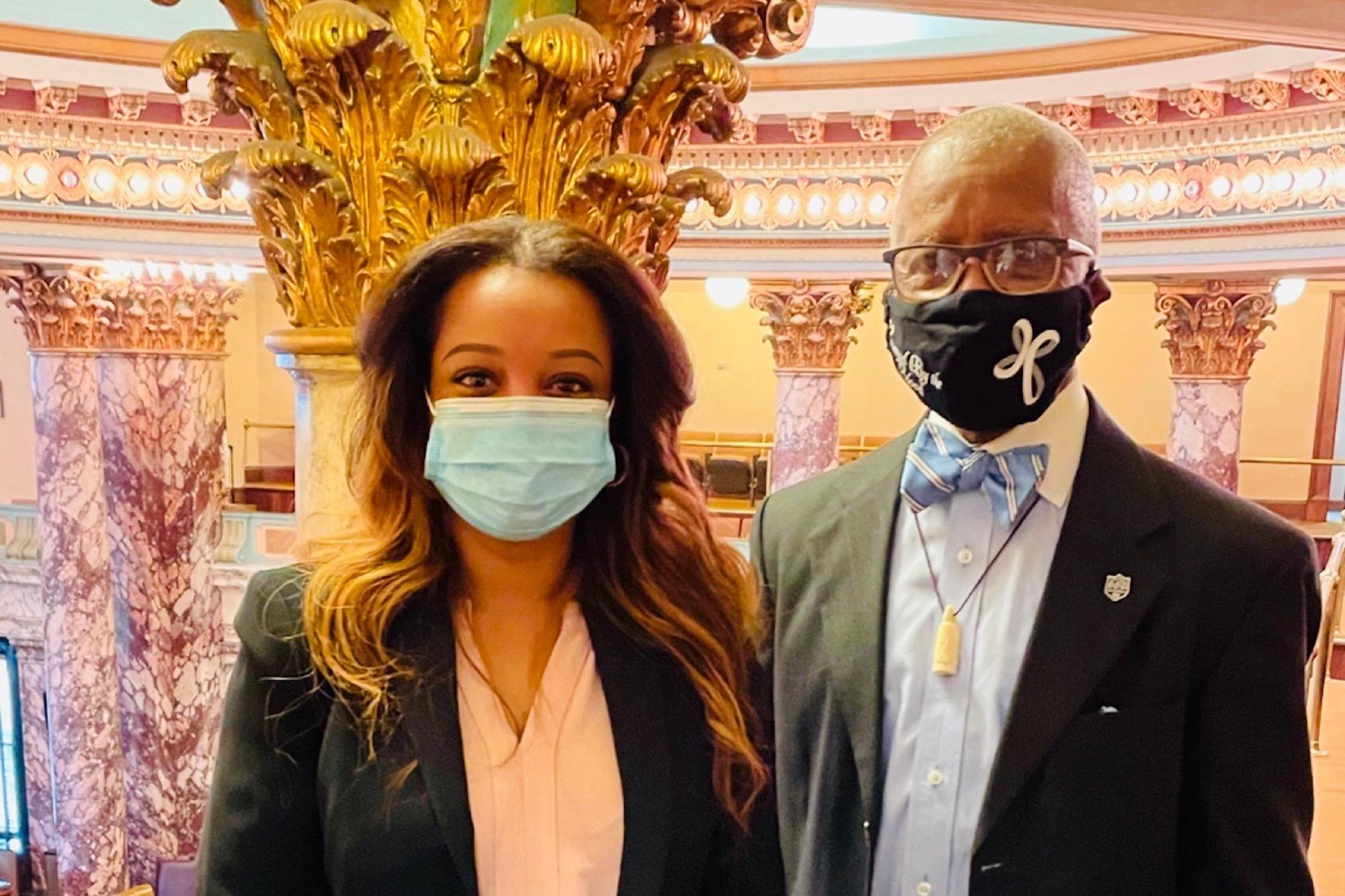 Crystal Welch and Senator Hillman Frazier, both wearing masks, stand inside the U.S. Capitol rotunda