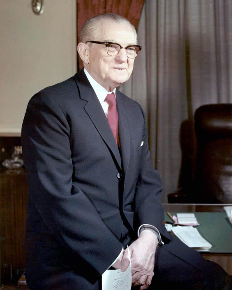 John C Stennis sits at his desk