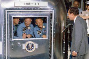 President Richard M. Nixon welcomes the Apollo 11 astronauts aboard the USS Hornet