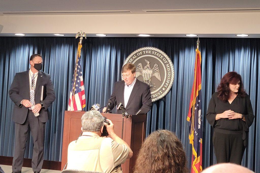 Tate Reeves at podium
