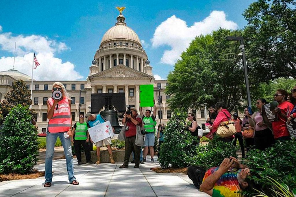 abortion rights activists speak in front of the Mississippi Capitol building