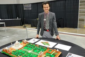 Rocco Buttlier standing in front of a lego build
