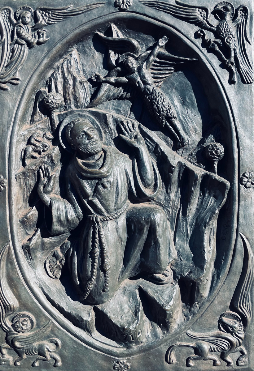Relief sculpture of Saint Francis of Assisi kneeling before an angel